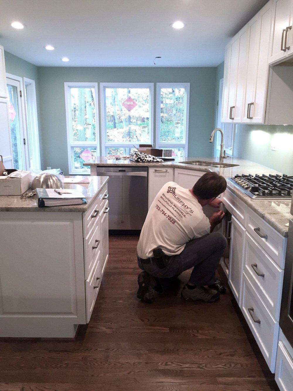 John Murphy finishing up detailed work on a Fairfax Virginia kitchen.