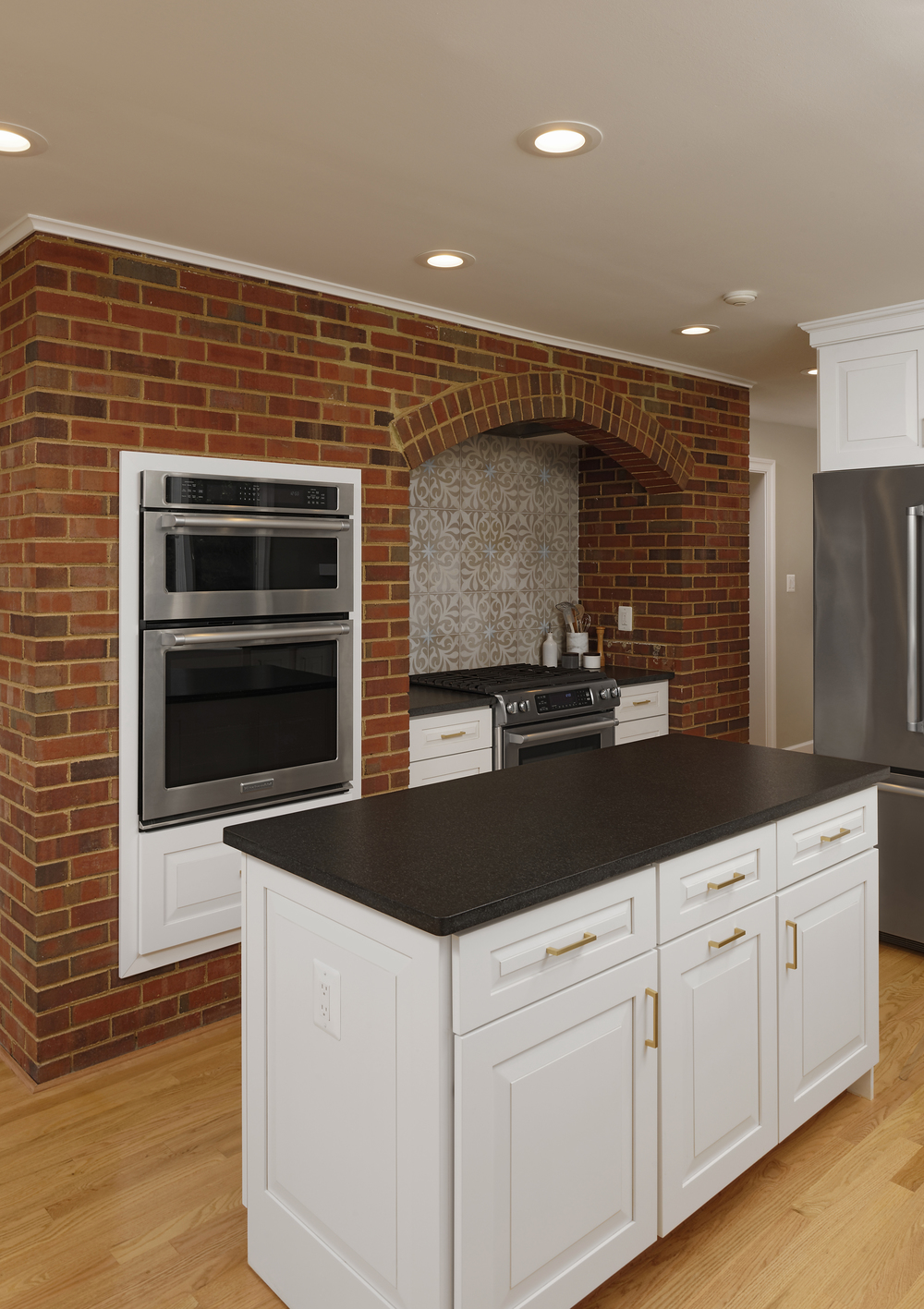 Clifton Virginia Kitchen Remodel using White raised panel cabinets and honed jet black granite.
