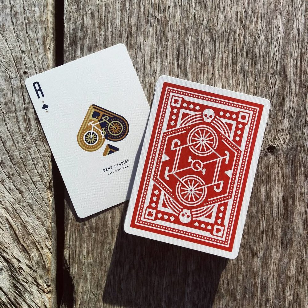 Red Wheel Playing Cards by DKNG