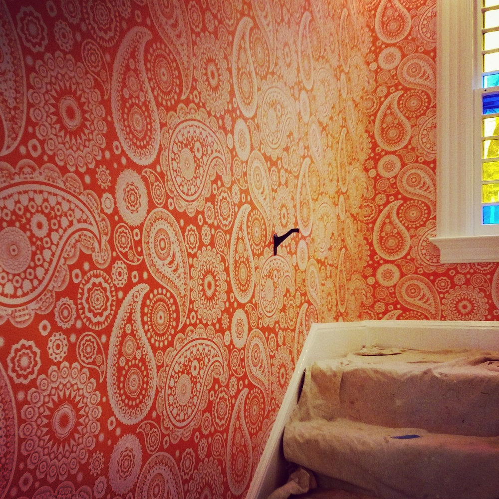 Mini Moderns Paisley Crescent wallpaper in Tangerine Dream.  The paisleys have lil houses and bikes in them!