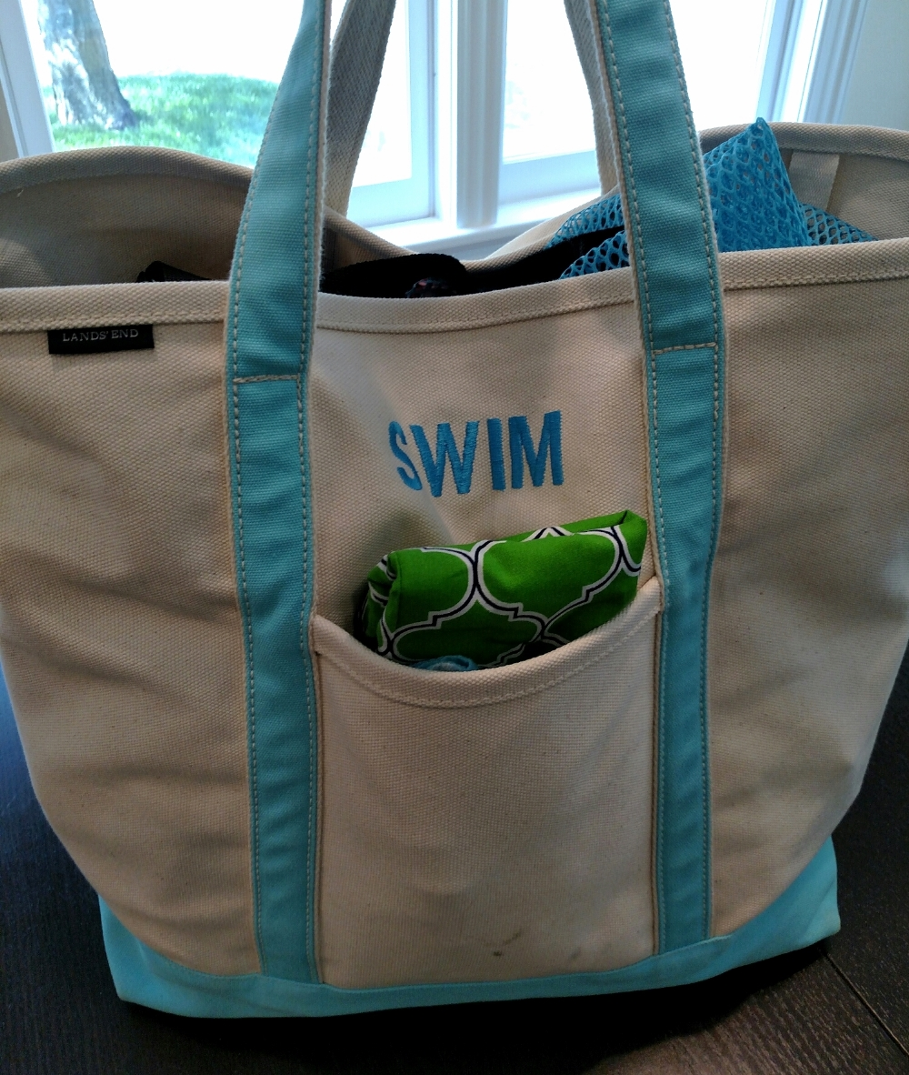 a fully packed swim bag, complete with mulch stain from last year
