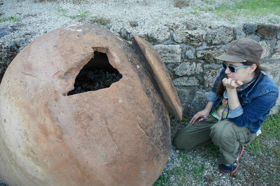 Staring down a dolium, or large storage vessel, Pompeii, Italy, 2014. Photo courtesy Caroline Cheung.