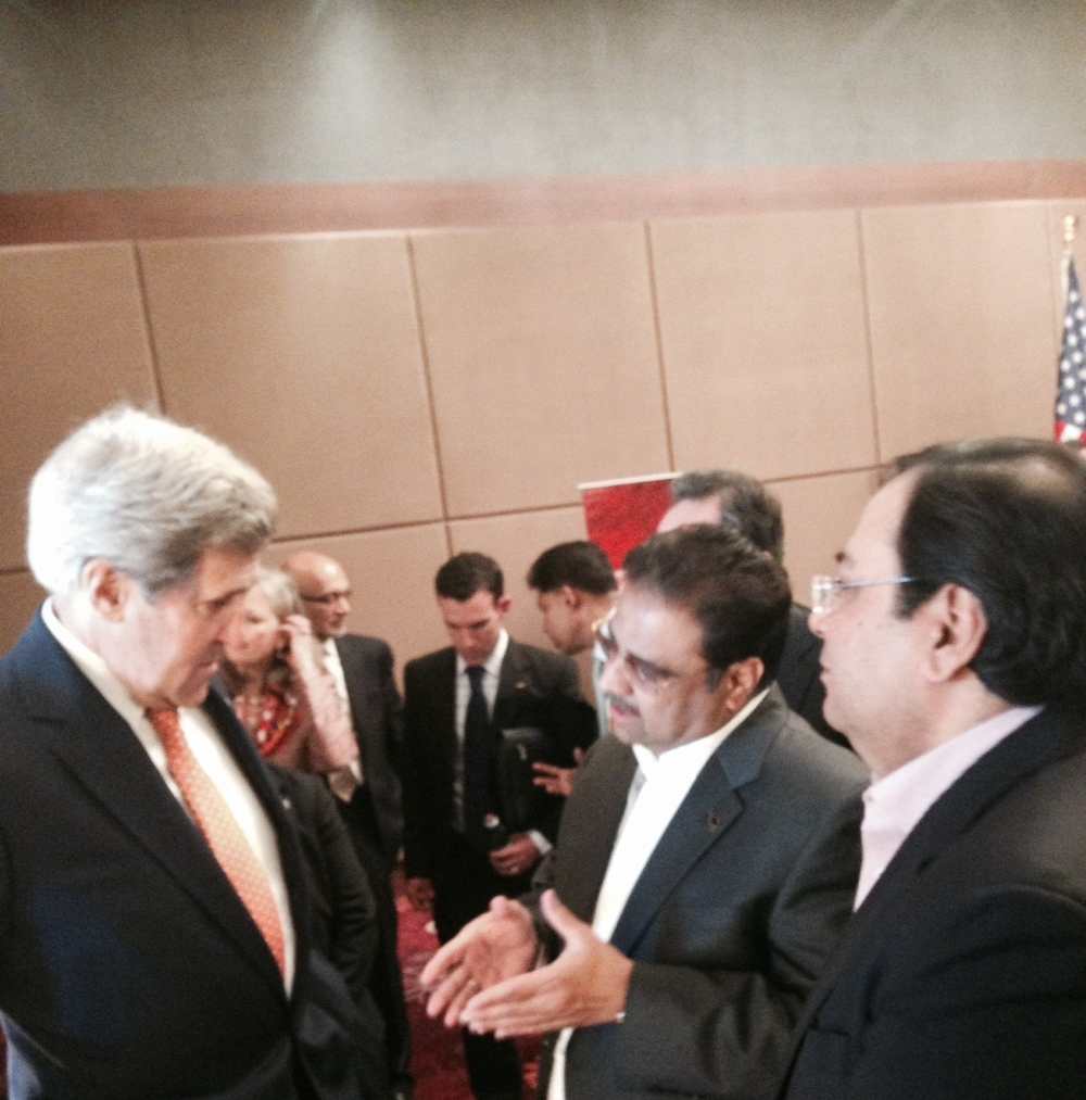 Suresh Nichani, Vice Chairman of RootCorp (right) with Honorable John Kerry, United States Secretary of State (left), and Mr. Danny Gaekwad (middle).