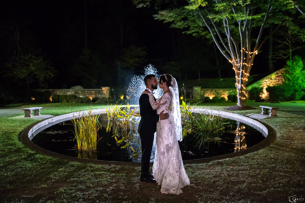 Bride and groom - Strong Mansion Wedding Photos - by the fountain