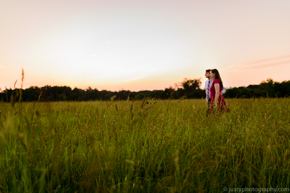 Beautiful engagement couple walking in field. Washington, DC engagement photographer.