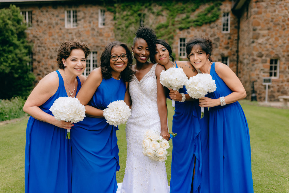 Bride and bridesmaids with bouquets.