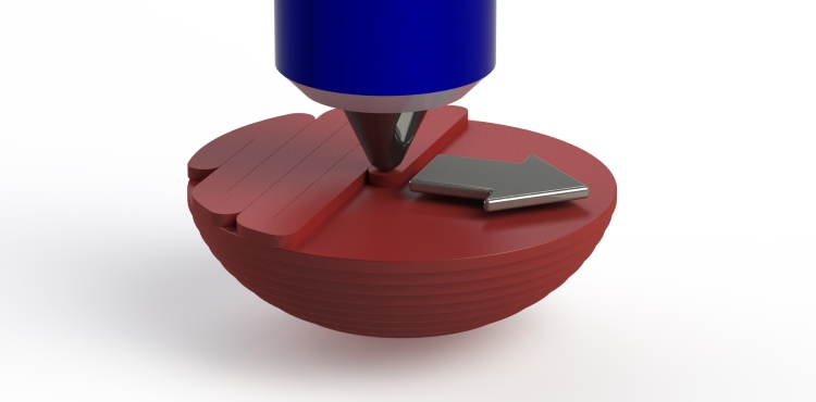 3D Printing a single layer of the rubber ball. The nozzle will pass back and forth in a zig-zag fashion across the part in the direction of the arrow to create this layer.