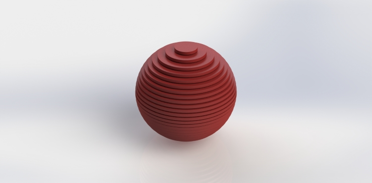 The finished 3D Printed ball with all the layers reconstructed. Notice the stair step-like surface that results from the layered based fabrication process of 3D Printing (the stair stepping effect is exaggerated here for visualization purposes).
