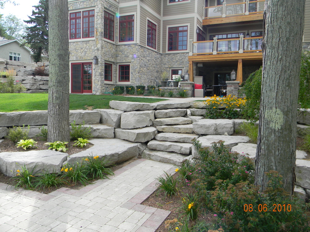 Walkout Basement with Limestone Boulder Stairs and Retaining Wall