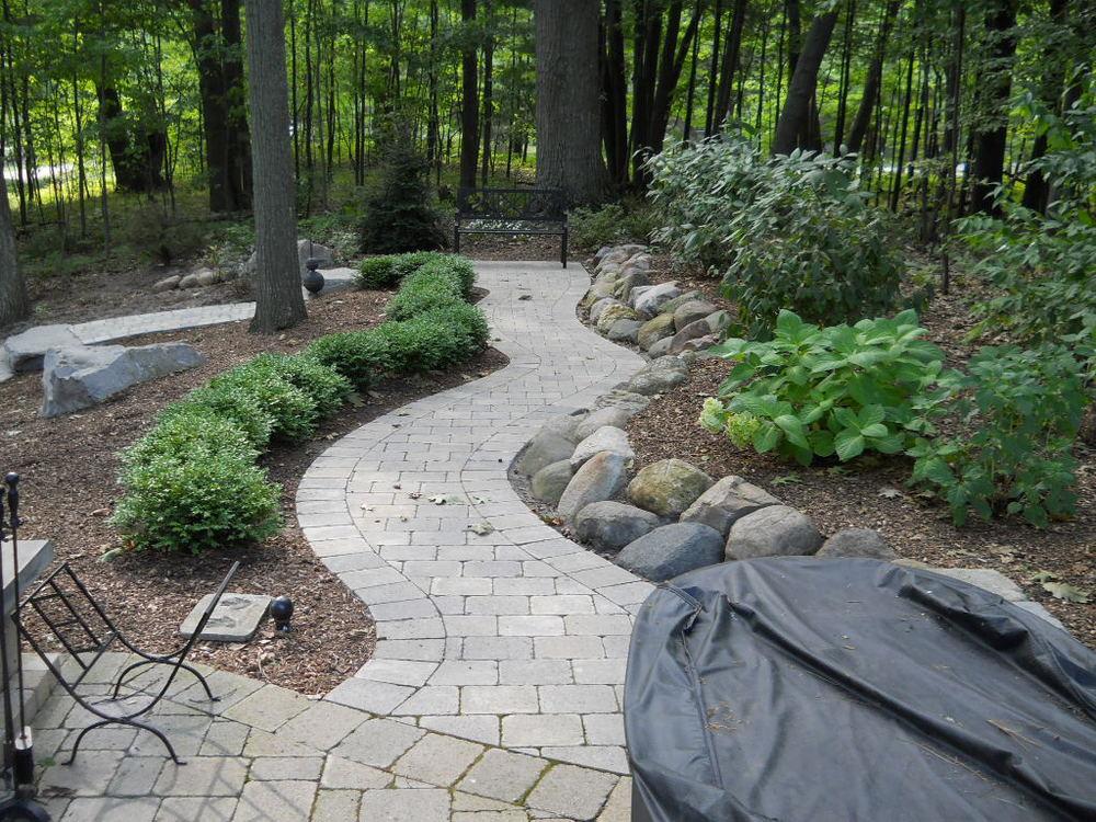 Winding Brick Paver Walkway in the Woods