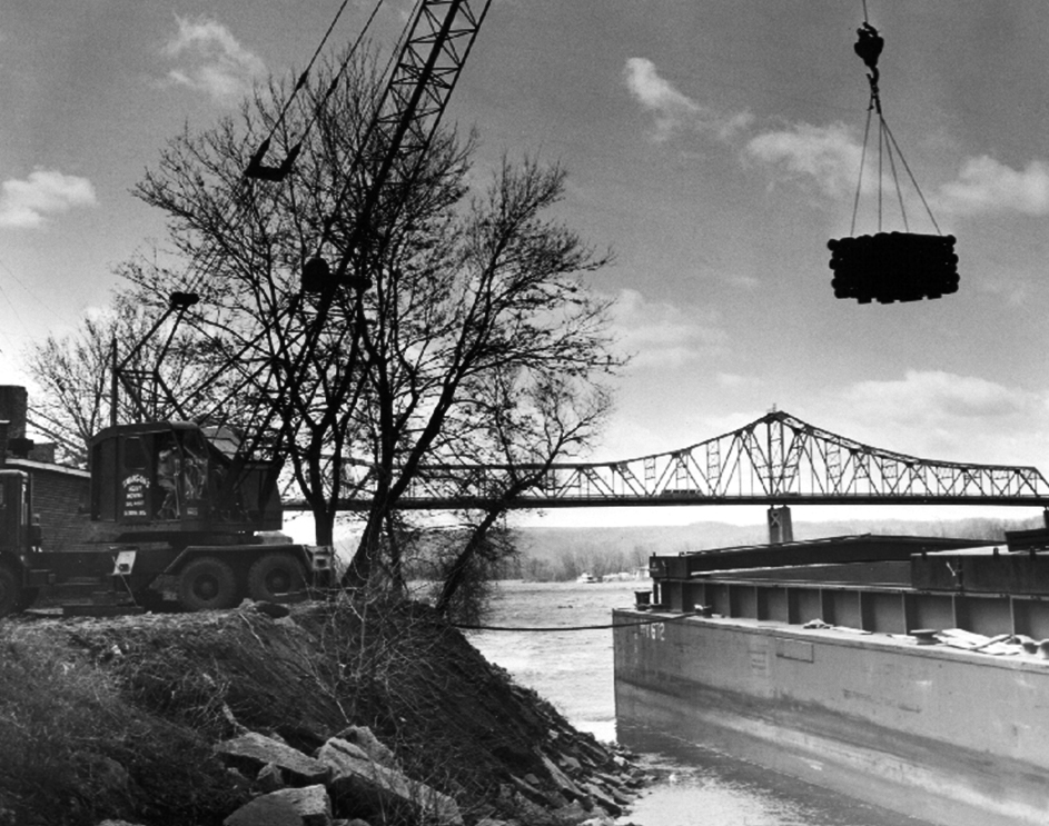 lacrosse_barge_deliver_pipe_mississippi_river_first_supply_gerhards_riverfront_historic_cass_street_bridge.jpg