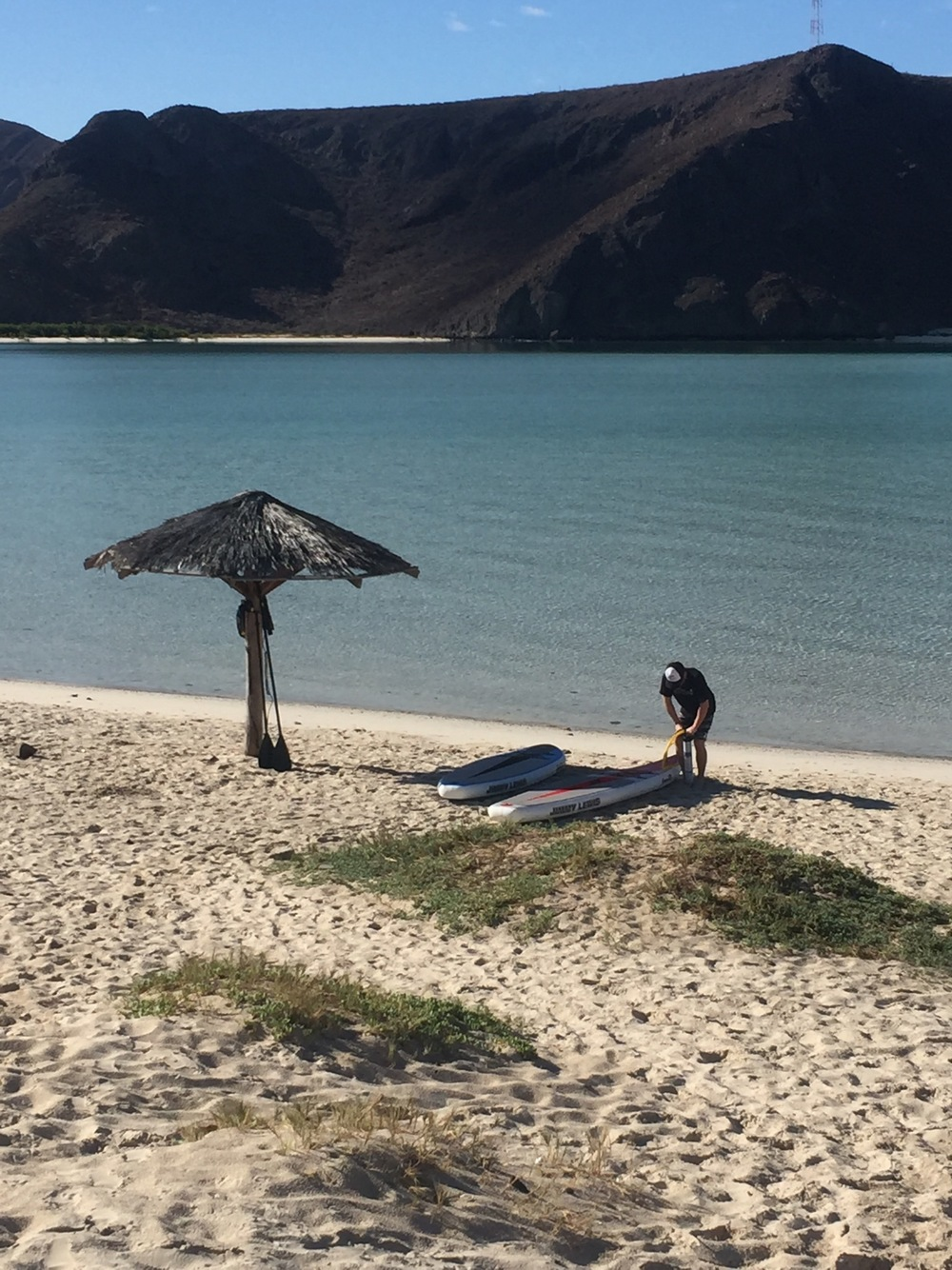 On another outing we used the shade of a random beach palapa while inflating the boards. In total it took less than 10 minutes to pump up both boards to around 15psi. The last few pounds of pressure take a bit of muscle, but once you get into a rhythm it's not bad.