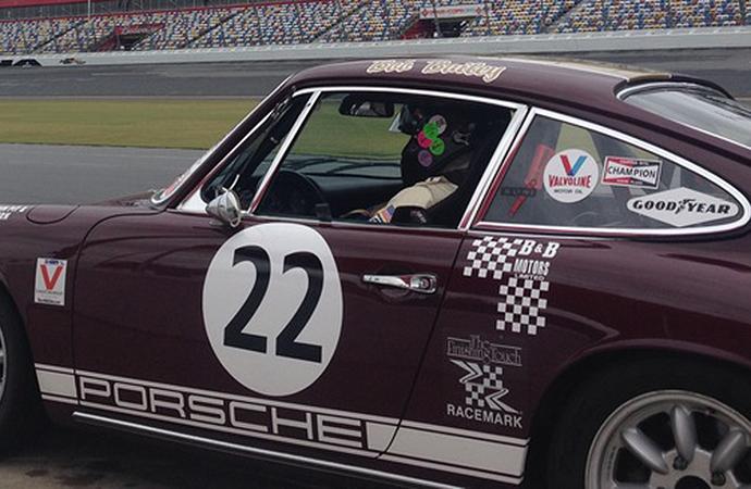 Bailey is seen sitting inside his treasured No. 22 Porsche 911.