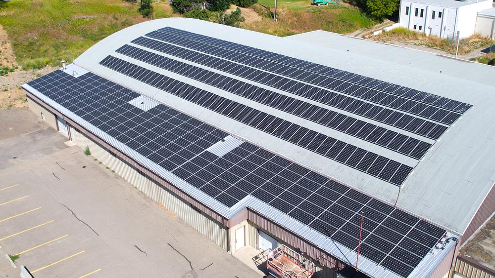 406 350 watt solar panels producing 160 mega watt hours of electricity every year.