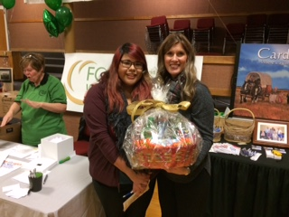 Cllr. Paula Brown awards a gift basket on behalf of the Cardston and District Family and Community Support Services.