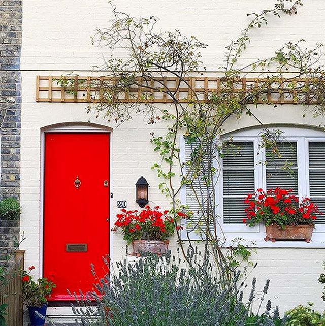 Getting in the holiday spirit! Love this red door and those window boxes are just the cutest