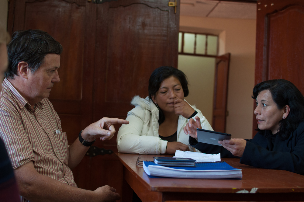 Dr. Tom Love discusses a possible field work site and medicinal plant supply chain with community leaders in Huamachuco, Peru.