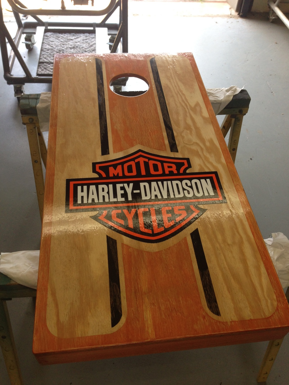 One of the custom corn hole boards in the silent auction