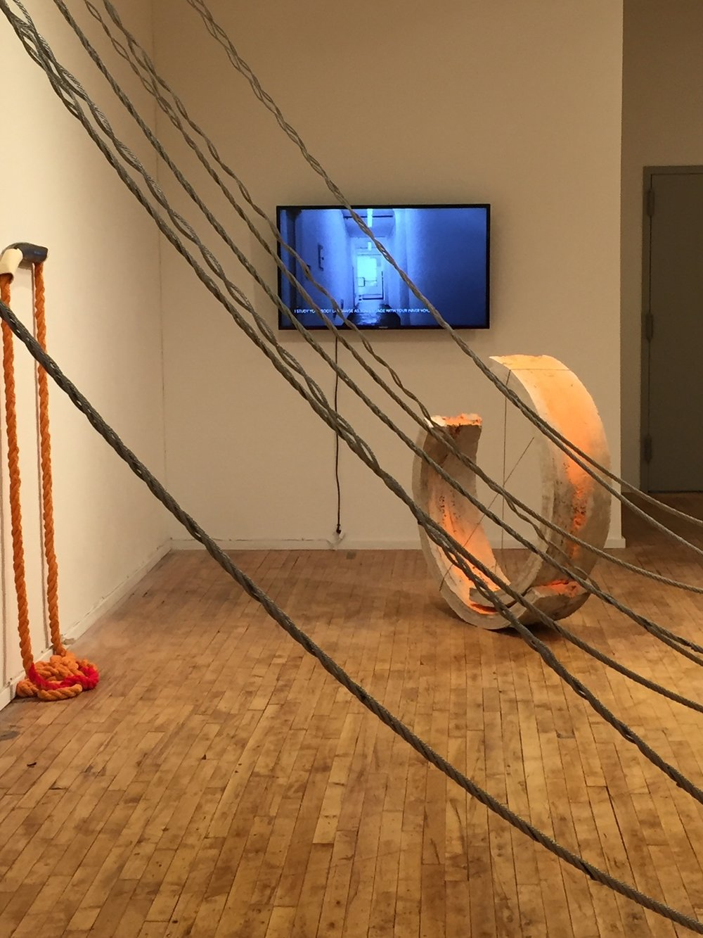 Front:  Crossover, steel wire rope   Back right:  Both, concrete, paint and cotton rope, 2017   Back left:  Glory, ceramic and construction chalk, 2017   Back:  Video, correspondence between collaborators, 2017