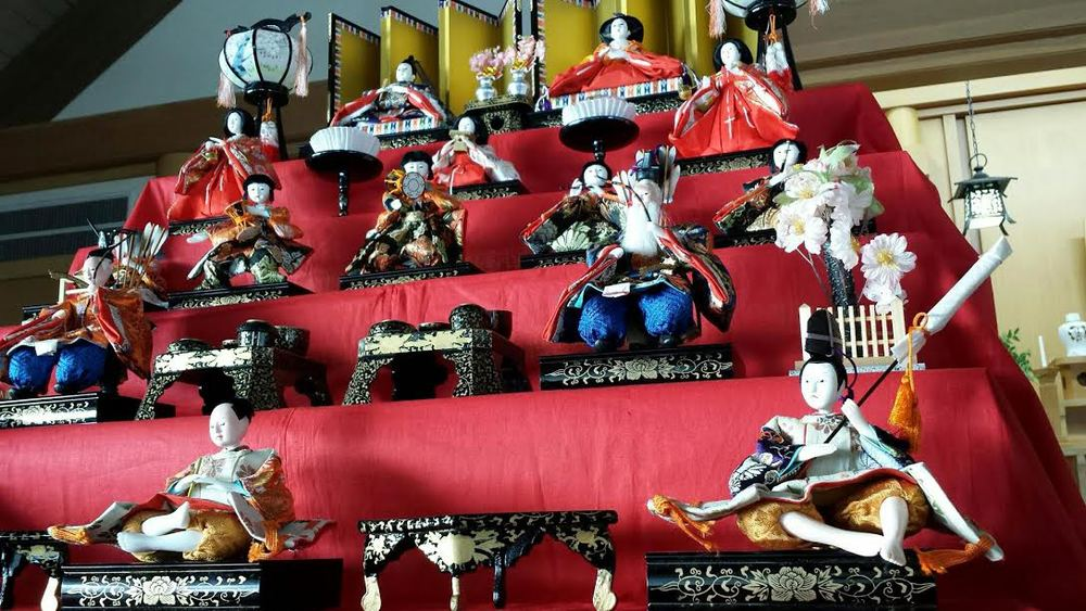 Hinamatusuri (Girls' Day) at Konko-Kyo Church. The Japanese Doll Festival (Hinamatsuri), or Girls' Day, is a festival celebrated by families who have girls, wishing their daughters good health and growth. Traditionally, beautiful dolls representing the      emperor, empress, attendants, and musicians were handcrafted especially for the occasion. The custom of displaying dolls began during the Heian period, when people believed the dolls possessed the power to contain bad spirits.