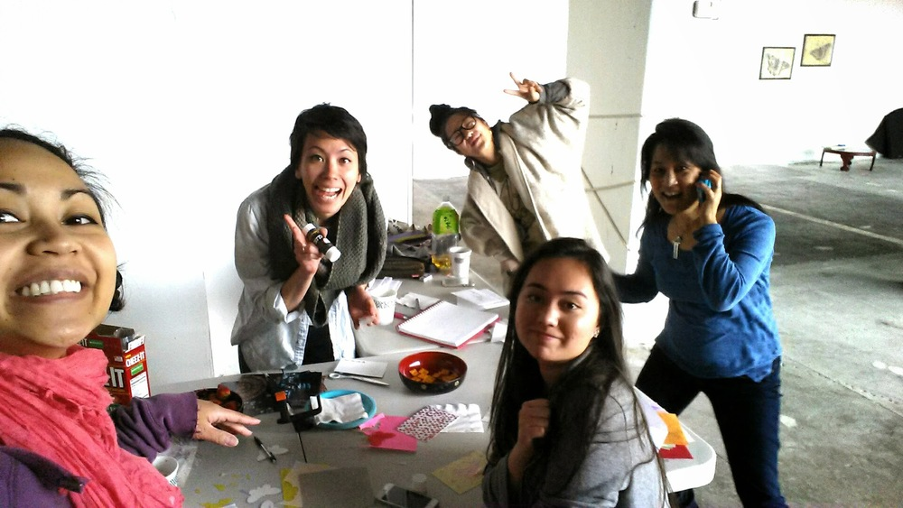 Silly photo of Charlene, Ayana, Eryn, and Jill working on the community collaborator cards.