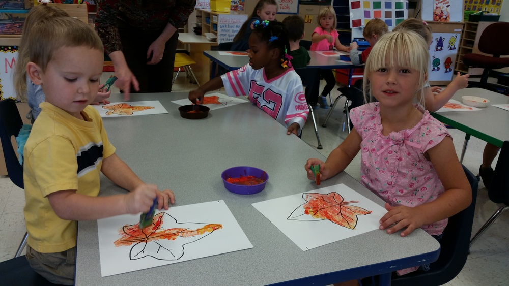 "We sponge painted ""fall"" colored leaves."