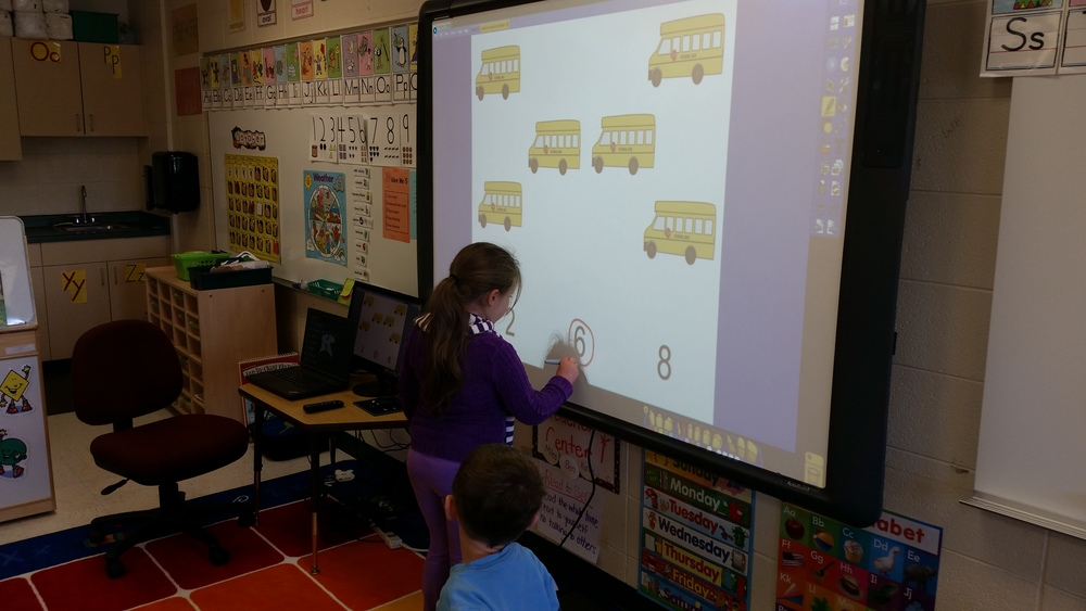 Playing a math game on the Promethean board during play time.