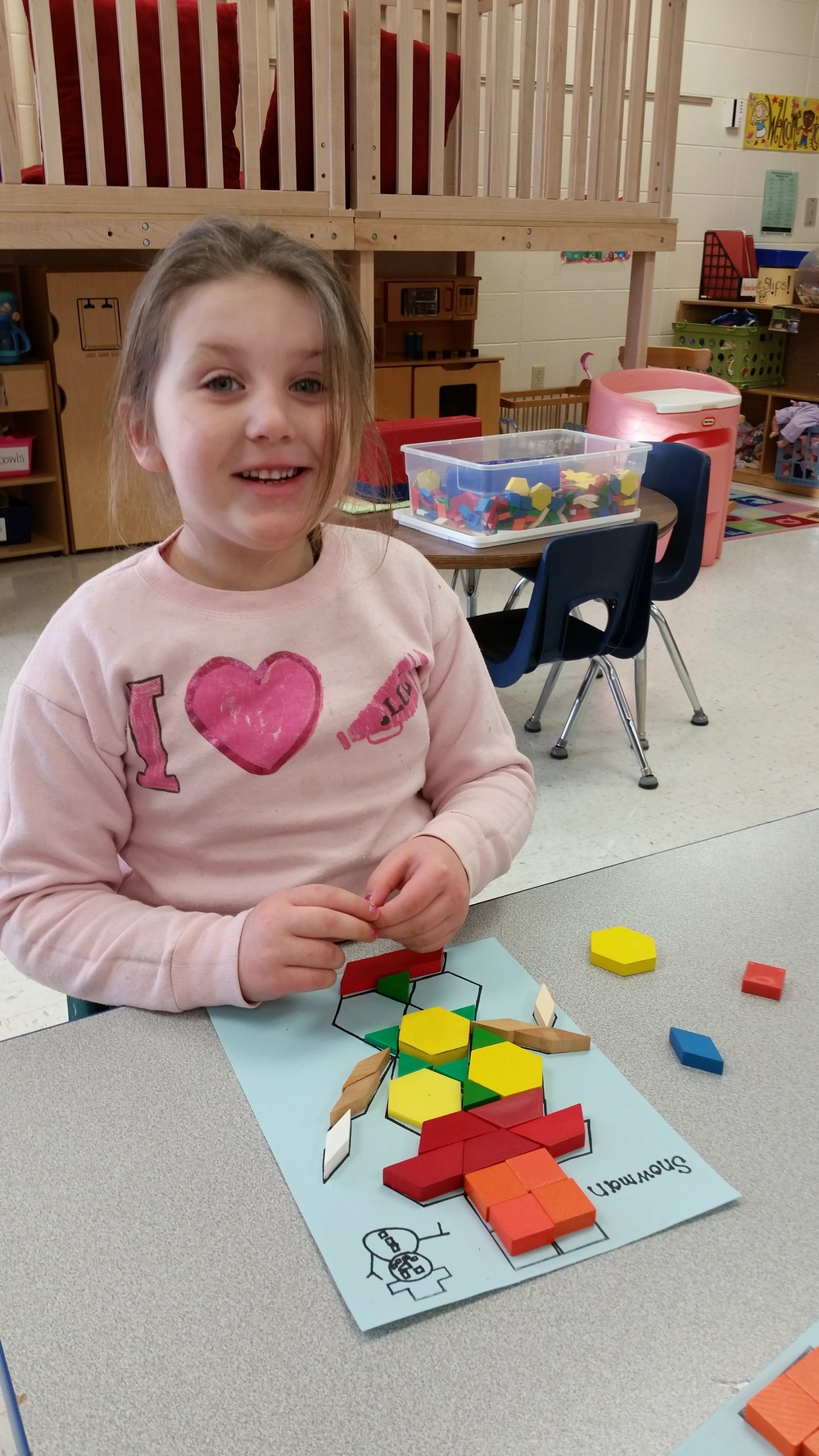 using pattern blocks to make a snowman