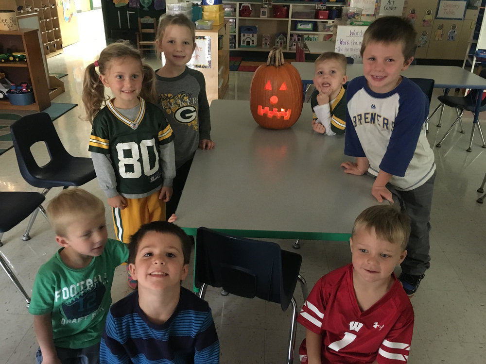 Group picture with the pumpkin we carved