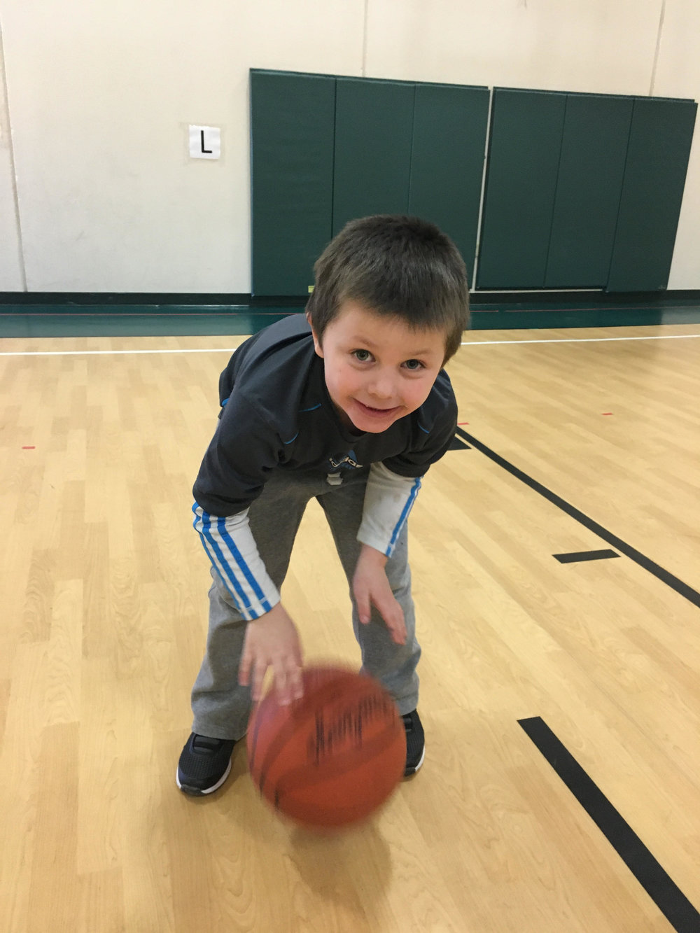practicing dribbling in gym class