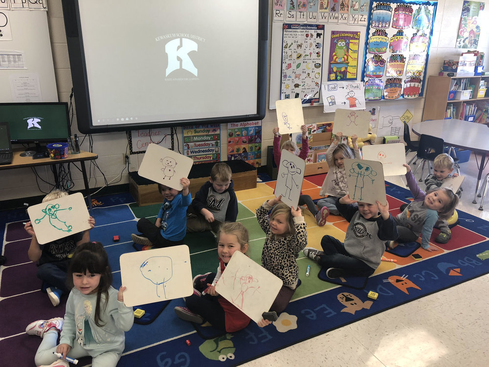 "we practiced drawing a person using the song called ""mat man"""