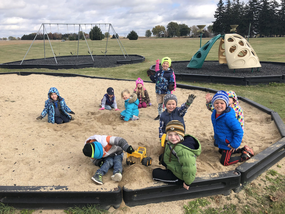 enjoying the sandbox at recess!
