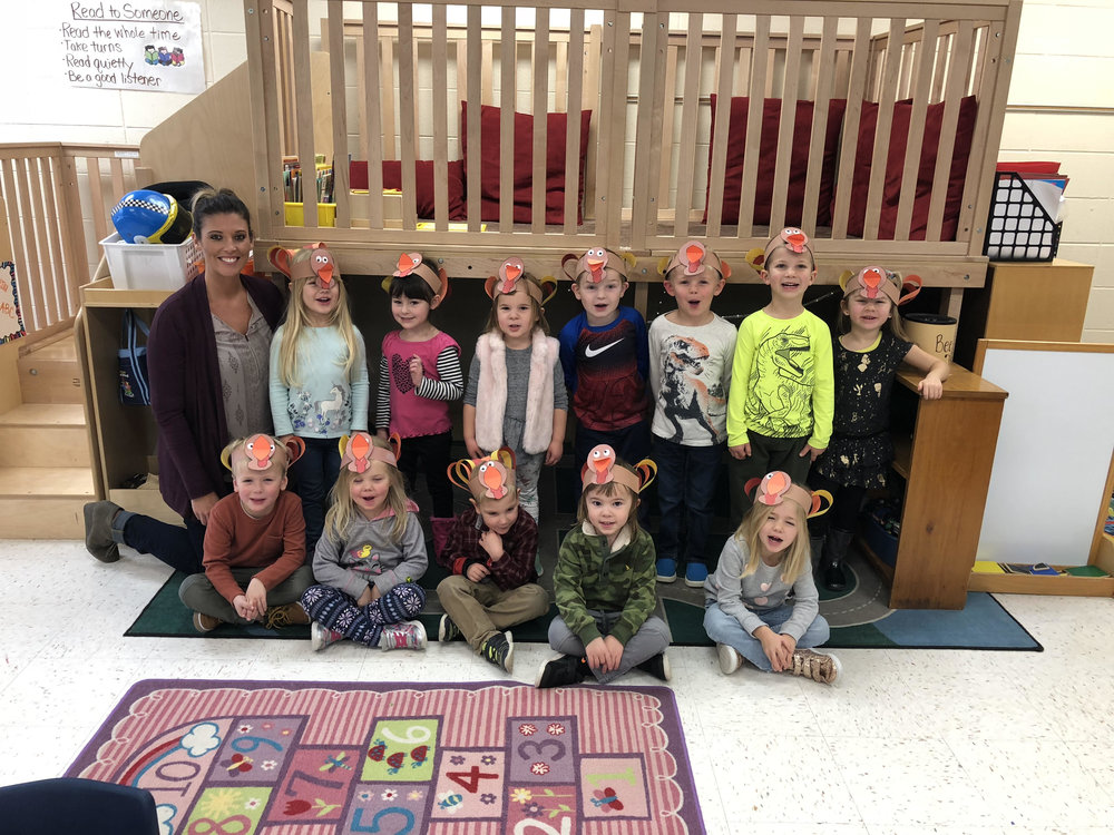 our class wearing turkey head bands