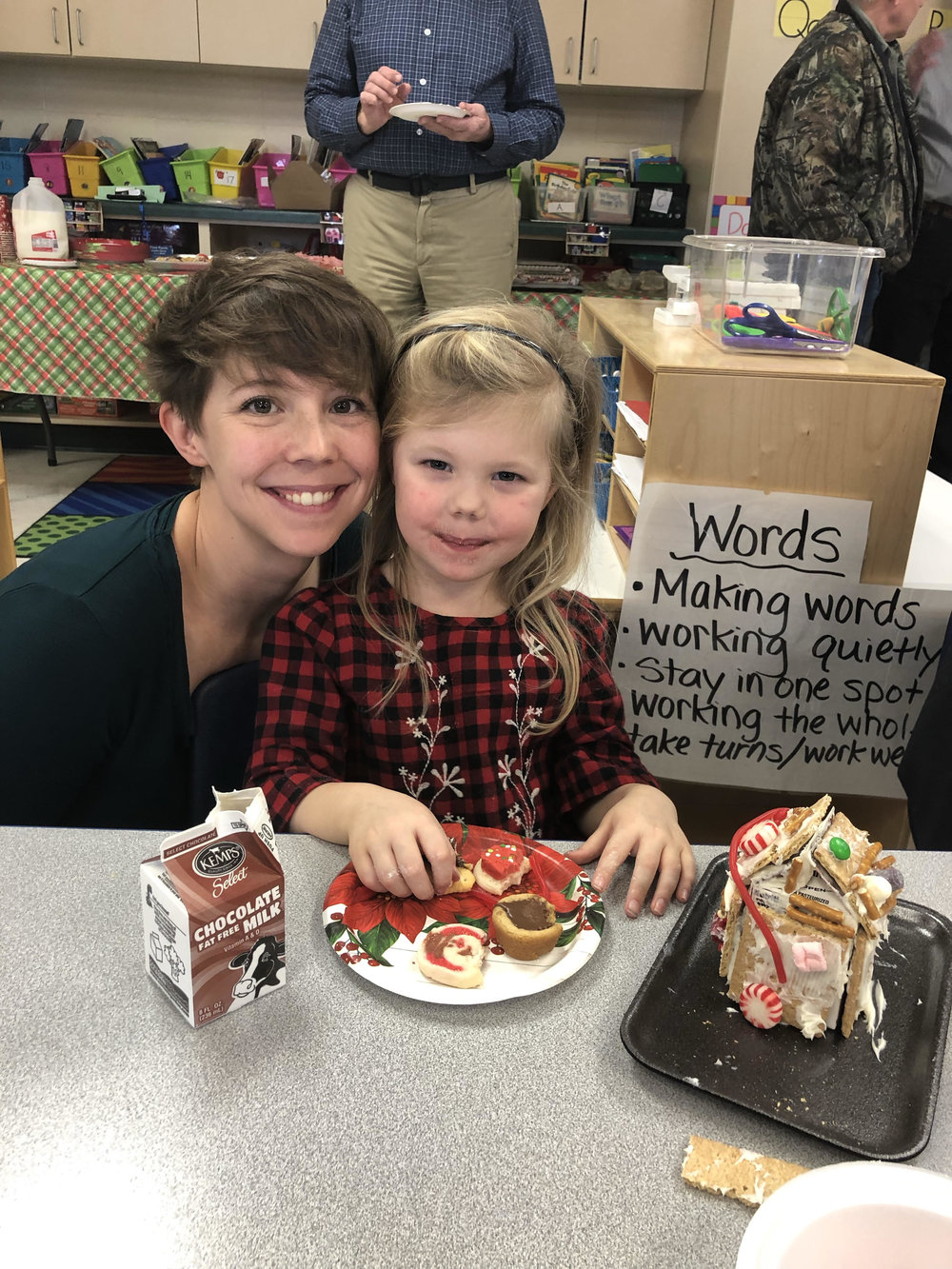 enjoying cookies after decorating gingerbread houses