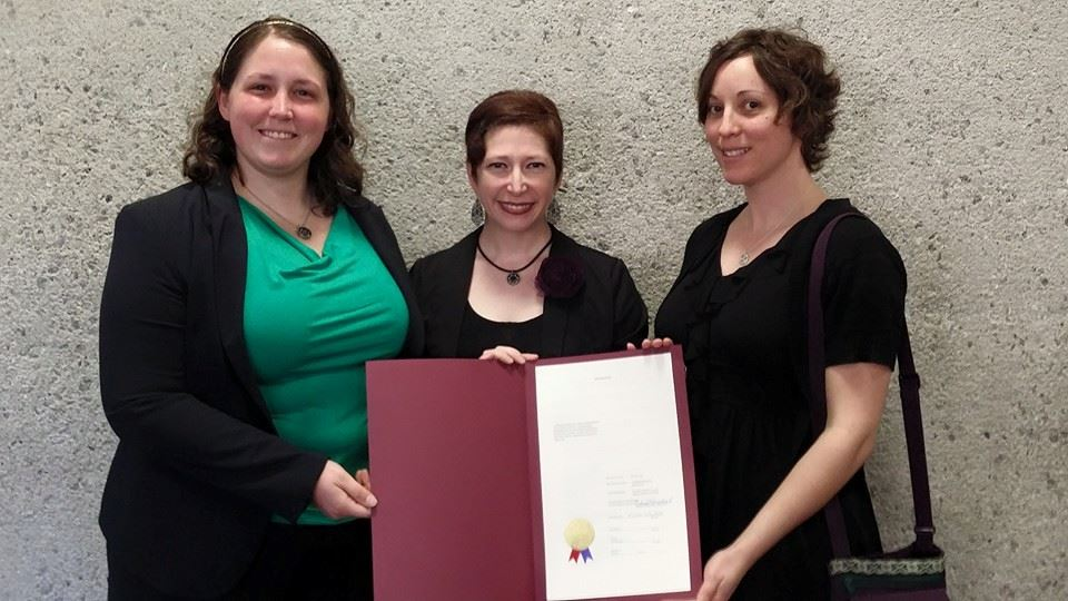 Agent Skaar, Wicked Wench and Space Riot accepted the County Commissioner's resolution honoring the Hard Knox Rollergirls.