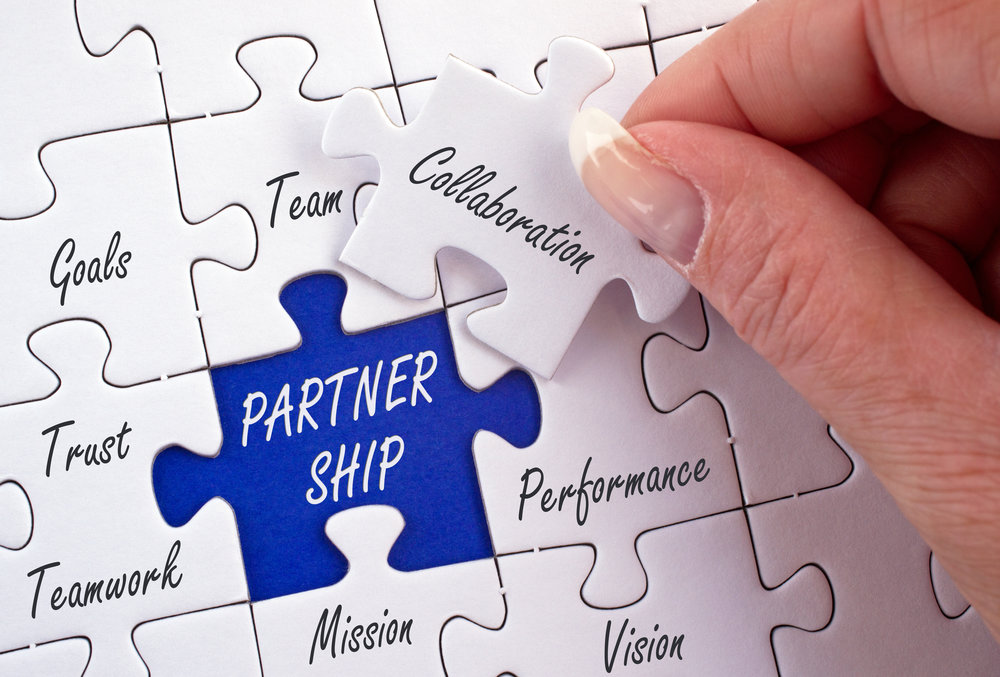 Partner - part·ner-noun1.  a person who takes part in an undertaking with another or others, especially in a business or company with shared risks and profits.