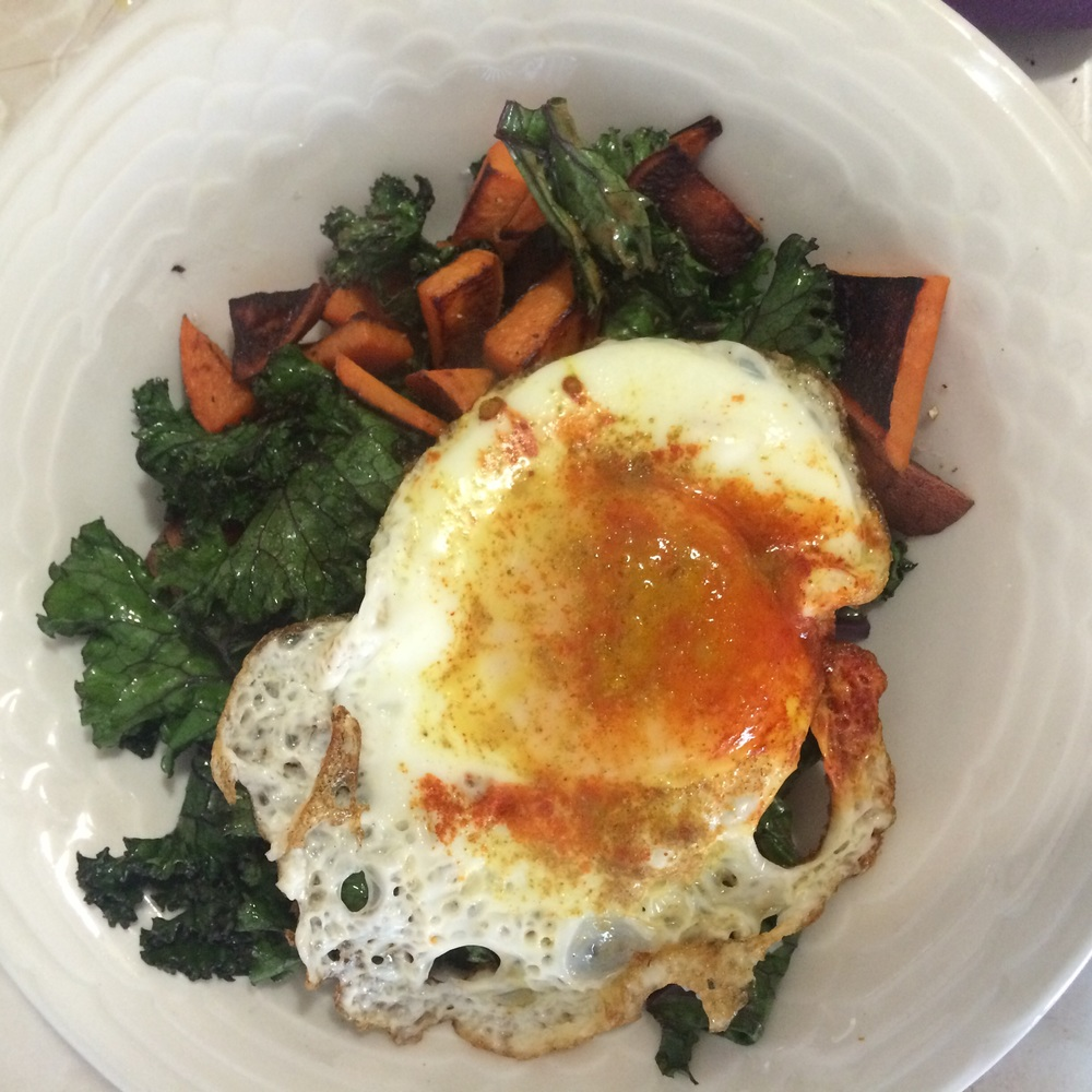 Sautéed kale and sweet potato with one fried egg with turmeric, cumin and cayenne