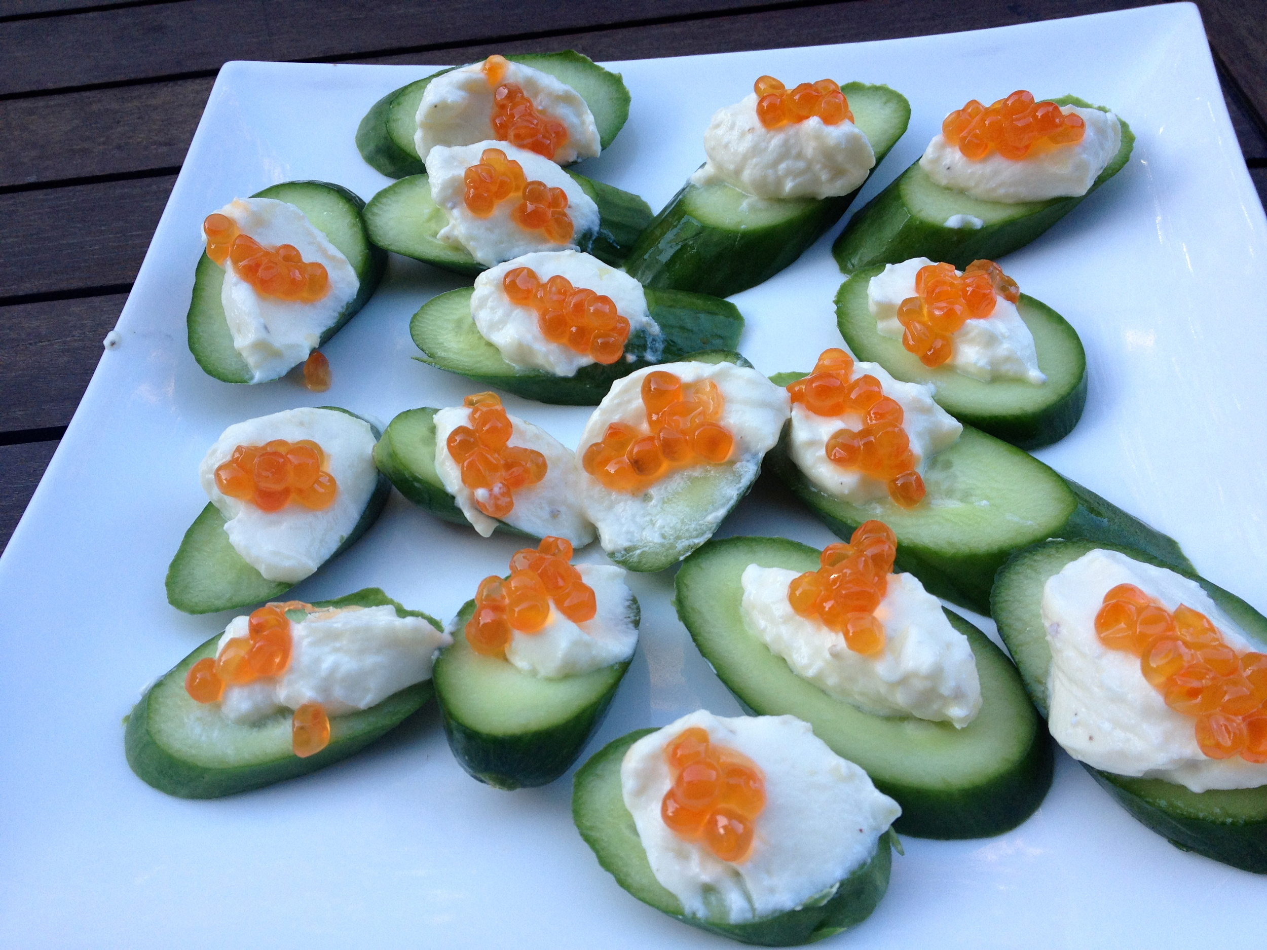 goat curd on cucumber slices with salmon roe