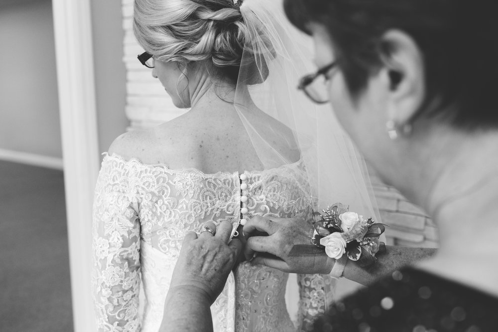 Buttoning the Wedding Gown