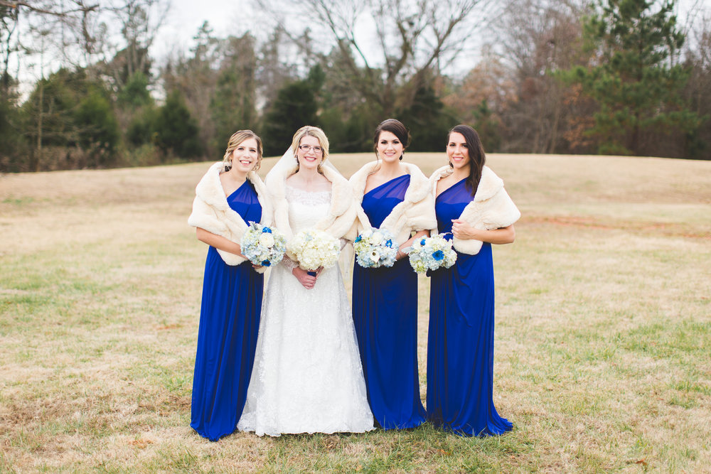 Bridesmaids with fur shawl winter wedding