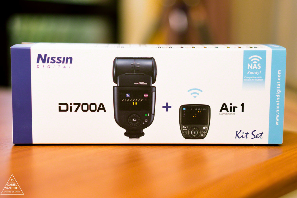 Box of Nissin Di700a Flash with Nissin Air 1 Commander