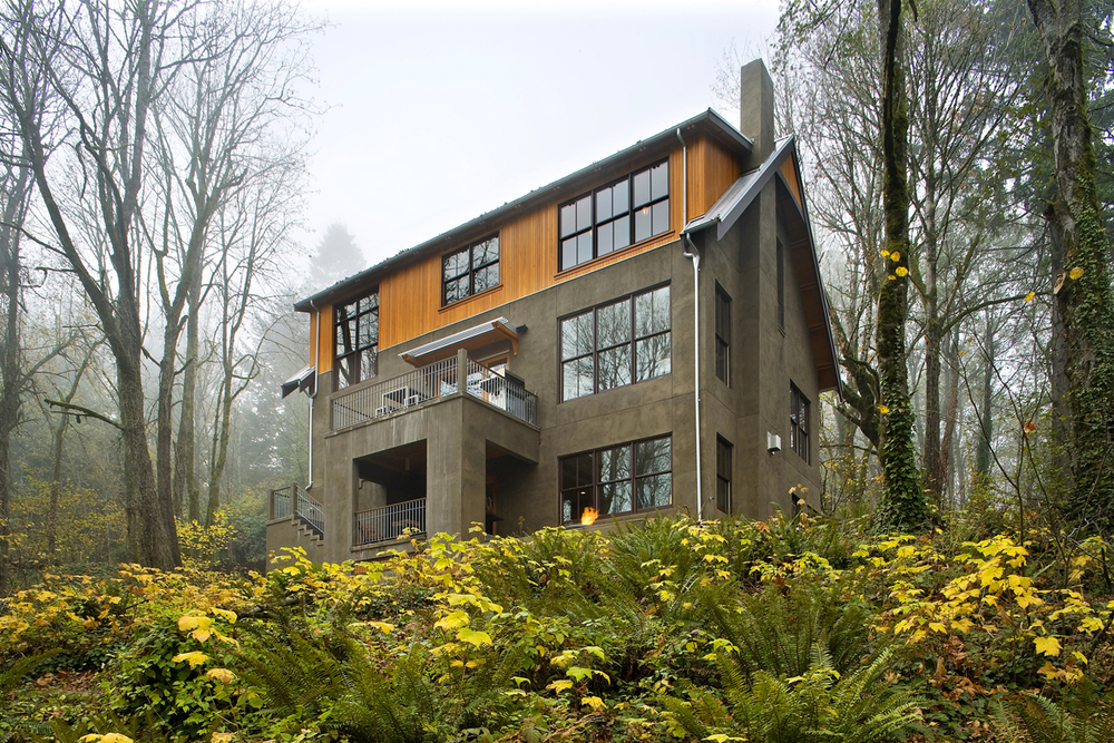 This residence bordered by the scenic Terwilliger Parkway and Marquam Trail System was the first LEED for Homes Gold project in they city of Portland Oregon. It sits between historic and modern stylings in a rustic landscape only minutes away from downtown.