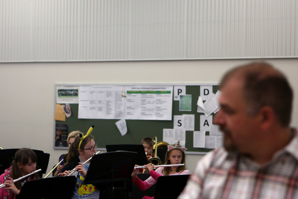 Nick Diedrichsen, a music teacher at Rowan County Middle School, directs his 6th grade band class on the Friday before Halloween.