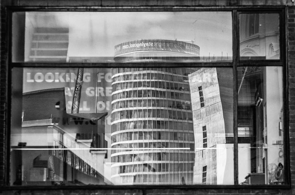 The Rotunda, Birmingham reflected in a window