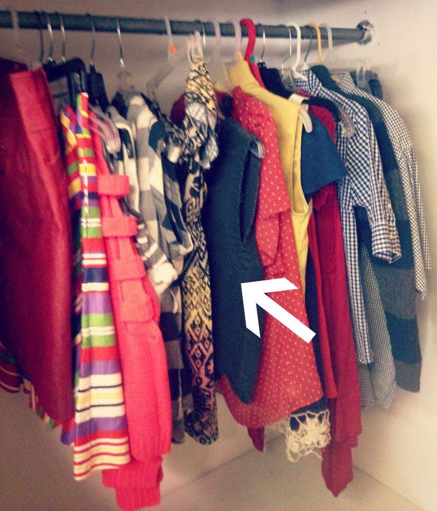 clothes on rack arrow