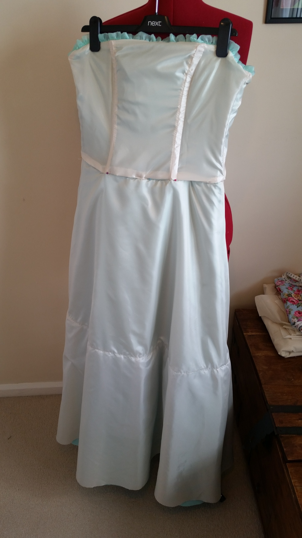The dress inside out. The stitching line on the skirt is where the ruffle is sewn in to give the dress more flare at the bottom.