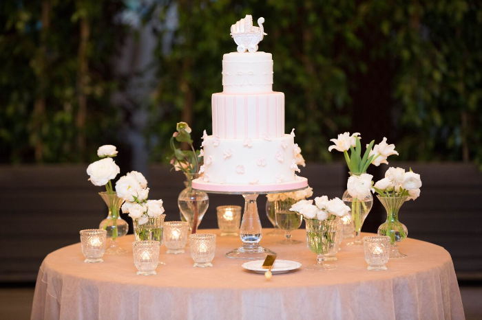 The delicious cake was adorned with soft pink stripes, flowers, and a classic baby carriage. Design & Coordination by Laurel Events LA.