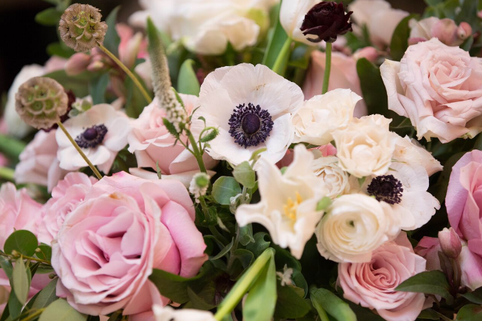 A close-up of the centerpieces full of garden roses and anemonies by Avant Garden. Design & Coordination by Laurel Events LA.