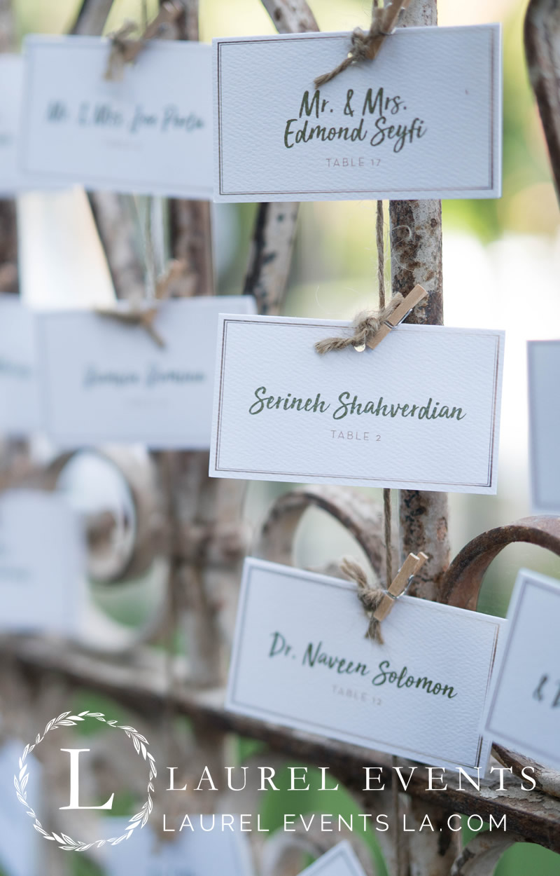 Hand-tied guest seating cards to iron gate