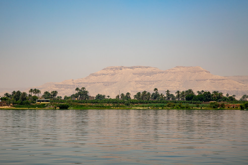 Nile River view of desert mountains surrounding the Valley of the Kings in Luxor, Egypt.